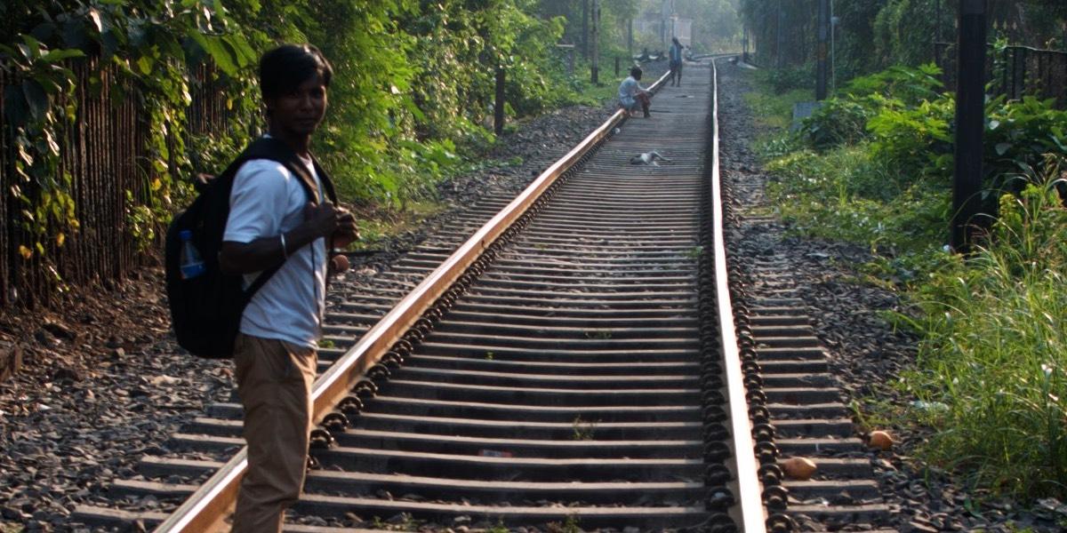 Raju by train tracks